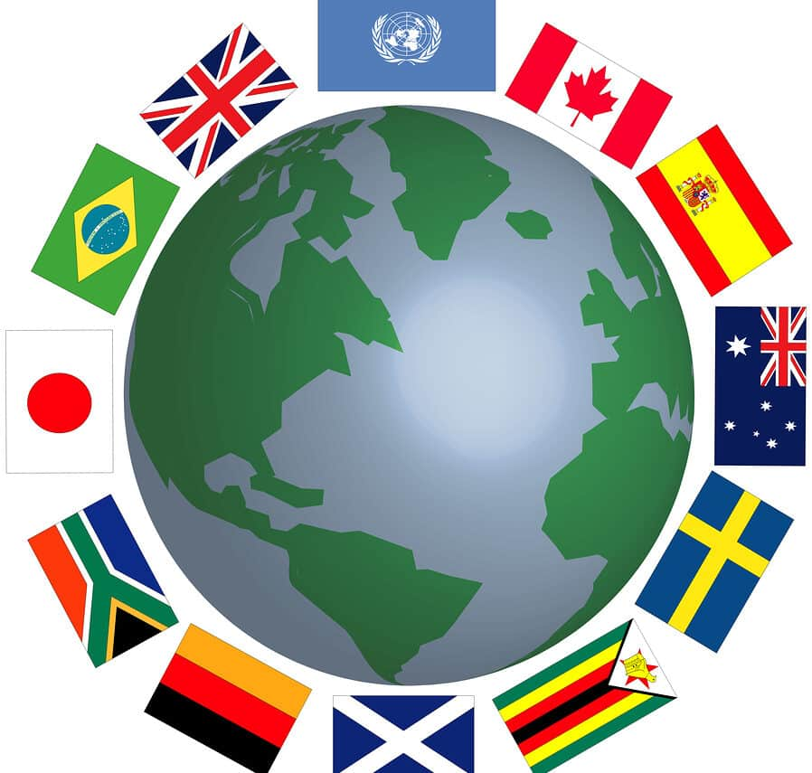 Colorful international flags wrapped around a blue and green globe.