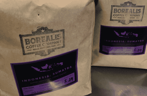 Brown bag filled with delicious local coffee beans from Borealis Coffee Company.