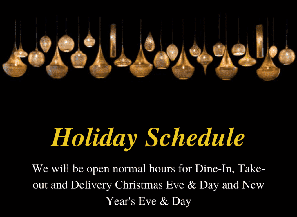 Amber glowing hanging lamps with holiday schedule printed under it.