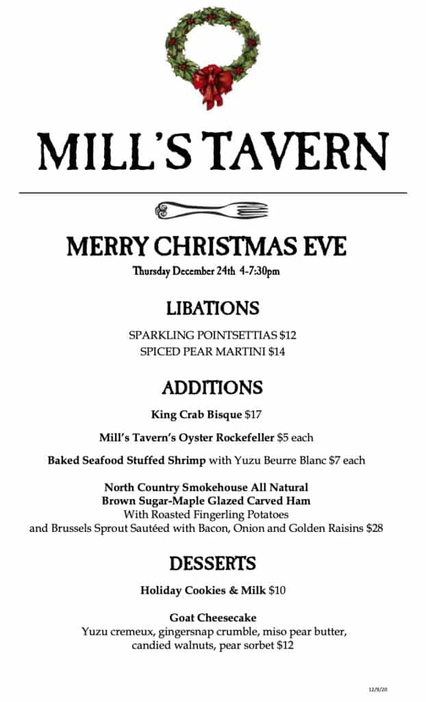 A white restaurant menu with black lettering featuring a christas wreath at the top center.