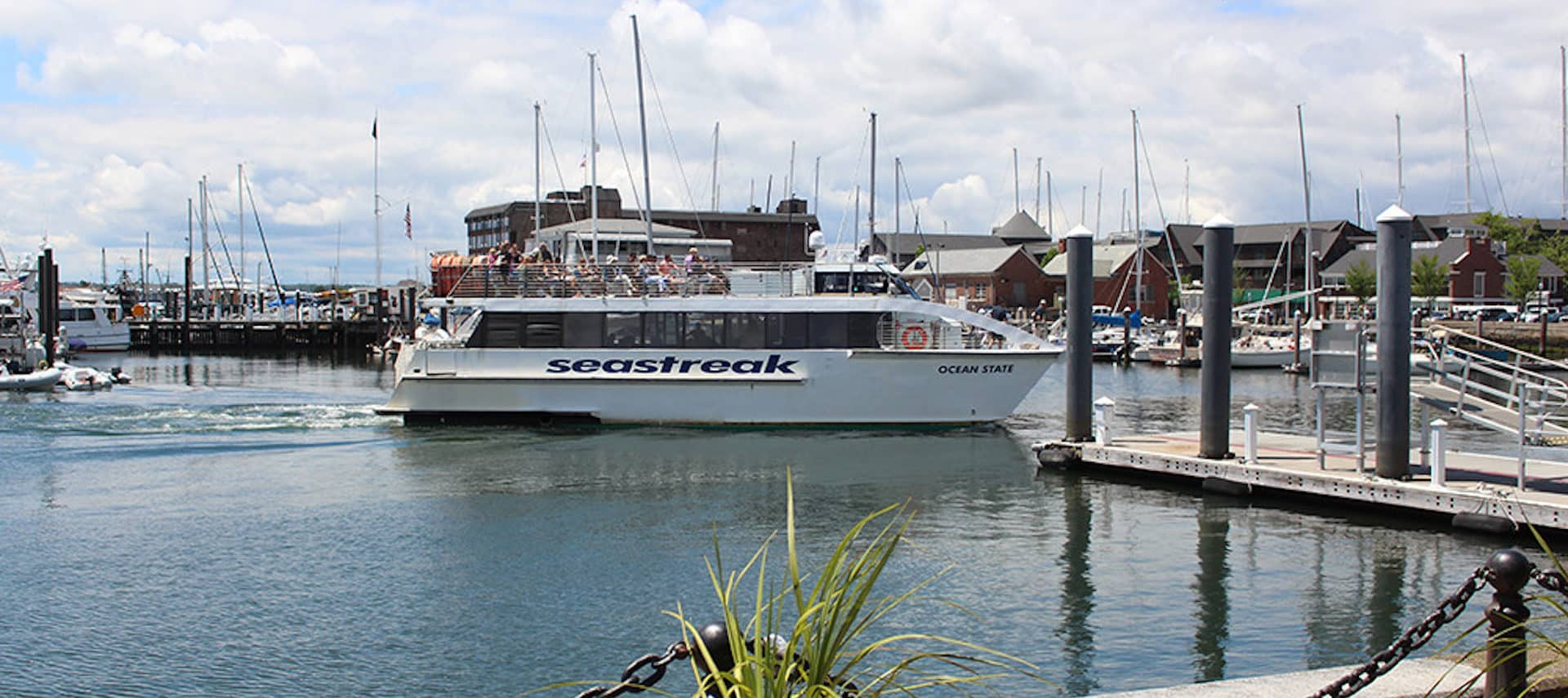 The Sea Streak Ferry docking in sunny Newport, Rhode Island.