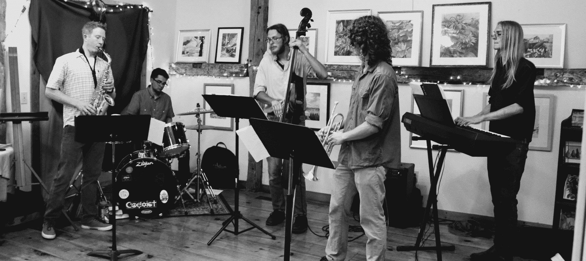 Black and white photo of a four piece jazz ensemble.