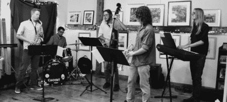 Black and white photo of a four piece jazz ensemble.