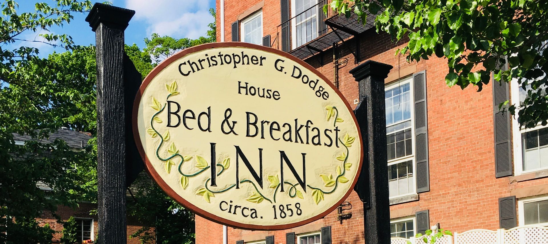 Hanging exterior sign for Christopher Dodge House