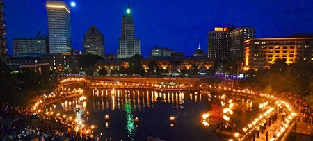 A river basin with anchored baskets set a blaze with a view of Downtown.