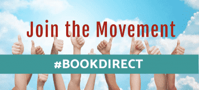 Hands giving a thumbs up in front of a book direct banner.