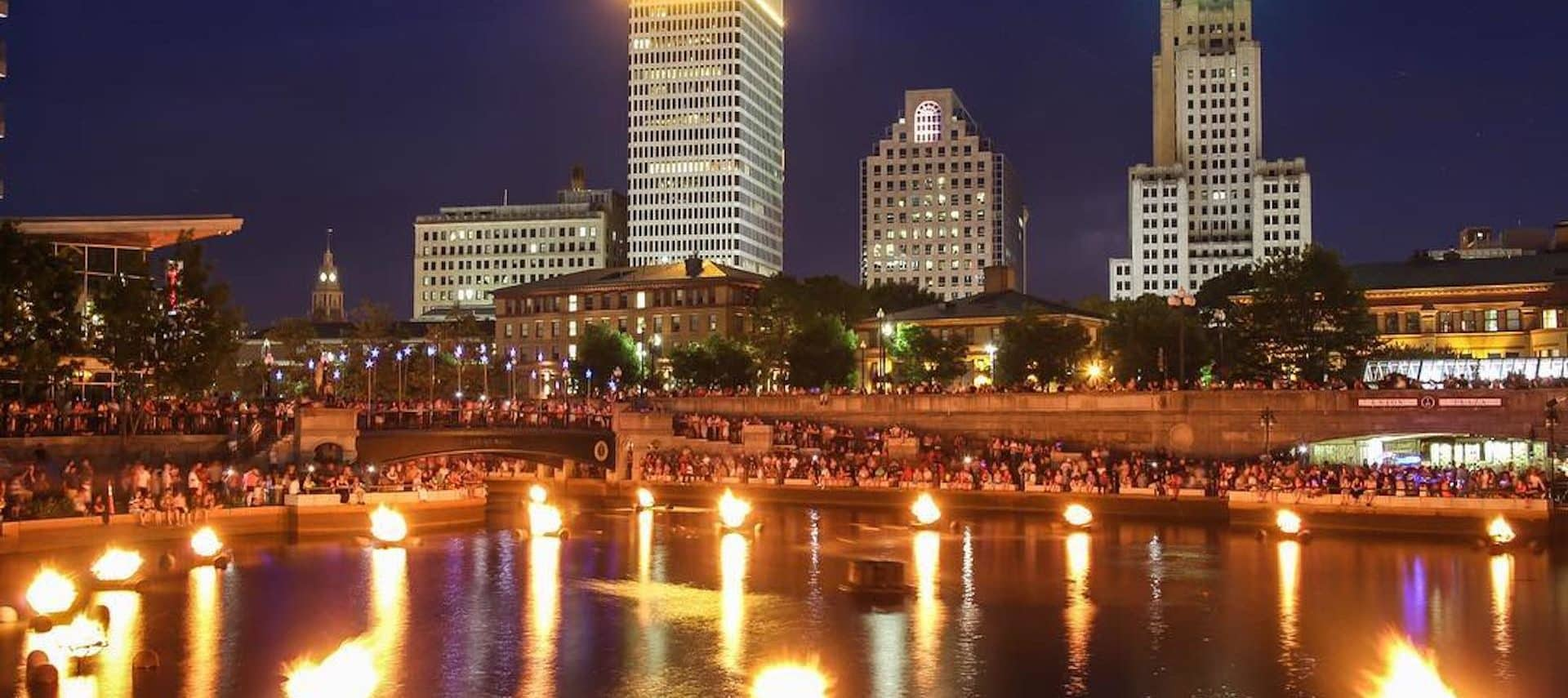 Braziers ignited on the river with the city of Providence in the backdrop.